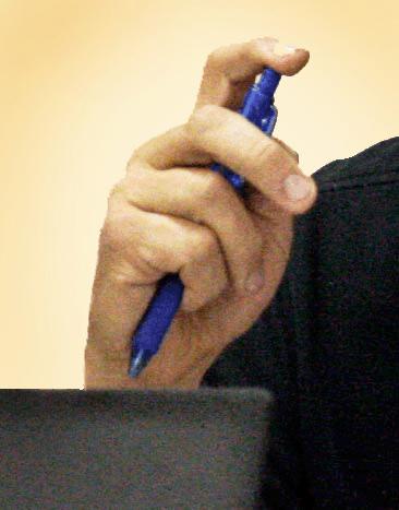 Calvin Owens finger on pen.